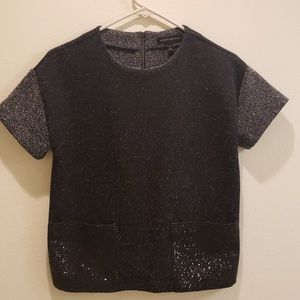 Black top with sparking pockets